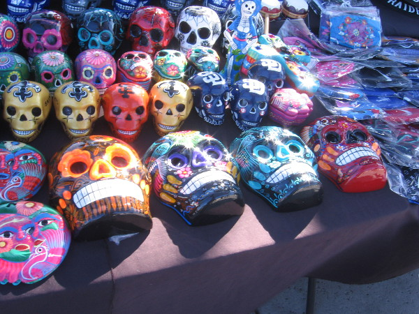A vendor was selling lots of colorfully decorated Día de los Muertos skulls.