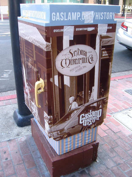 Artwork on a Gaslamp Quarter utility box shows historical photo of the San Diego Mercantile Co.