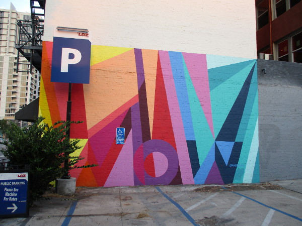 This colorful WOW mural is by Pandr Design Co., who've done work all over San Diego. Their artwork can also be found at various Major League Baseball stadiums!