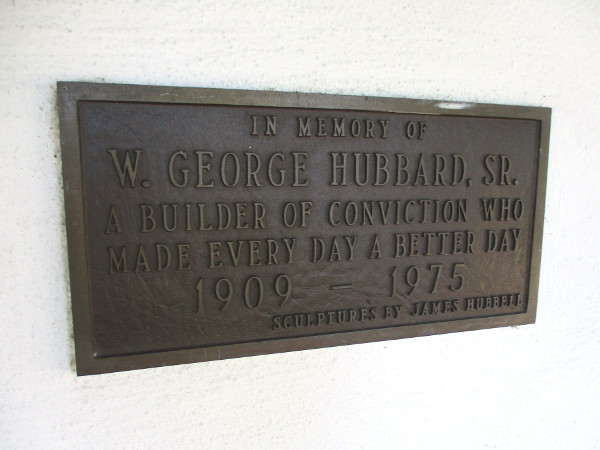 Plaque near the portico sculptures: In memory of W. George Hubbard, Sr. A builder of conviction who made every day a better day.