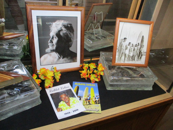 A museum display memorializes local surfers who've passed on.