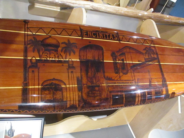 A redwood surfboard by Francis Todd II and Mary Krahn pays tribute to popular Southern California surfing destination Encinitas.