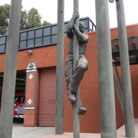 Firefighters descend pole outside fire station!