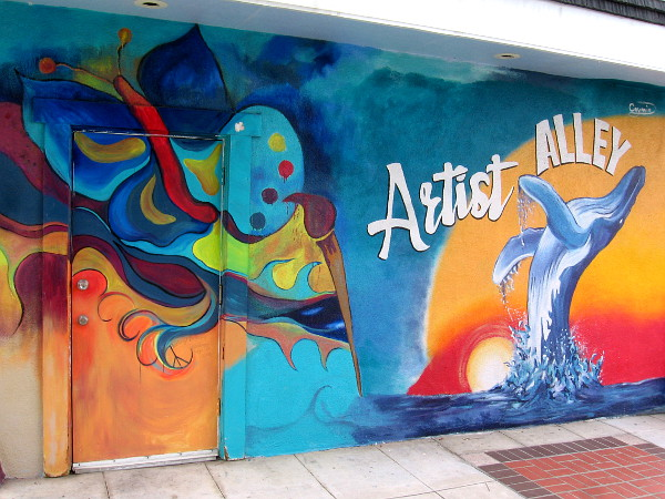 Mural at entrance to Artist Alley in Oceanside by Marilyn Huerta, and Caymin Charles Ellspermann.