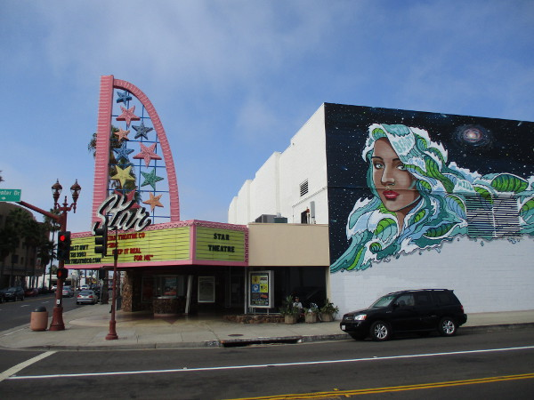 Large colorful mural on Civic Center Drive at the Star Theatre.