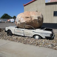 Huge boulder crushes car on L Street!