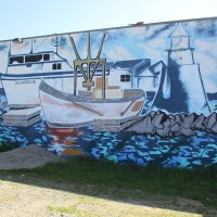 Mural depicts boats in Oceanside Harbor.