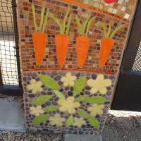 Mosaic art and a tractor at Civita Gardens.