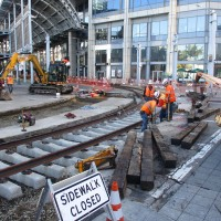 Working on the trolley tracks at America Plaza.